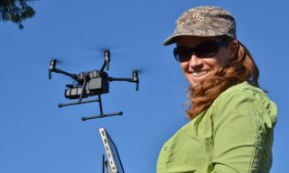 Deb demonstrating the Wildlife Drones method
