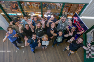 Attendees of DrupalCamp Byron Bay wave to the camera
