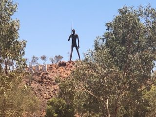 The 17m high sculpture of the Man on the Hill at Aileron Roadhouse.